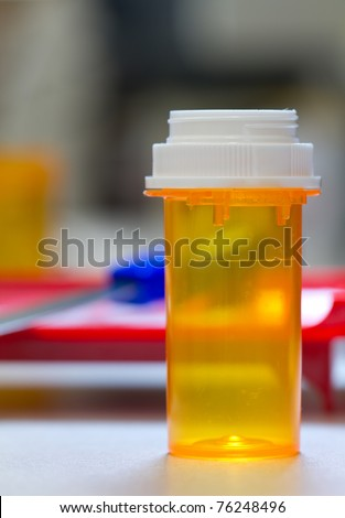 pharmacy vial ready to be filled, counting tray in the background