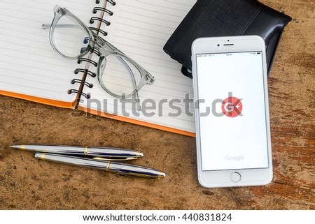 PHAYAO, THAILAND - JUNE 22, 2016: White Apple iPhone 6s Plus open Google+ application, Google+ is Google's social network service to compete with Facebook and launched in late June 2011 - stock photo