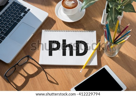 PhD Doctor of Philosophy Degree Education Graduation open book on table and coffee Business - stock photo