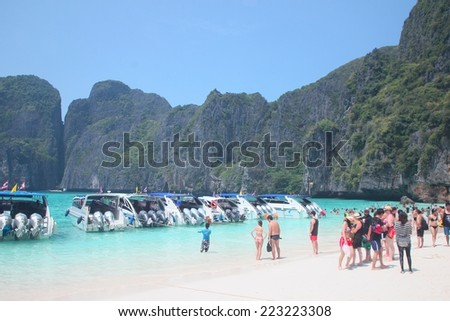 PHI PHI ISLAND, THAILAND - Oct 10, 2014: Unidentified tourists visiting biggest tourist attraction on Phang Nga Bay, October. 10, 2014 - stock photo
