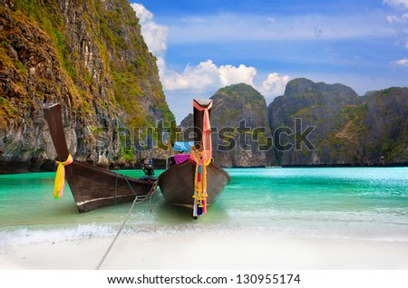 Phi Phi Island - Traditional longtail boat in Maya Bay, Thailand - stock photo