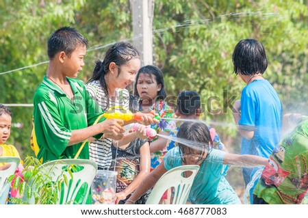 Phichit , Thailand - April 13, 2016 : Thai Kids Playing Water Songkran festival in Thailand, Kids Have A Lot Fun Playing With Water