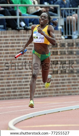 PHILADEDLPHIA - APRIL 30: Kenia Sinclair from Jamaica comes around the turn on the anchor leg of the Olympic Development Sprint Medley Relay at the 117th Penn Relays April 30, 2011 in Philadelphia. - stock photo