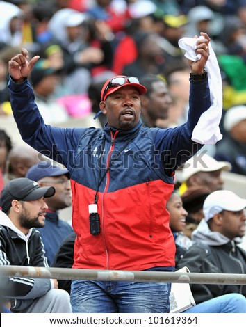 PHILADELPHIA - APRIL 28: A fan cheers on his team from the stands at Franklin Field at the Penn Relays April 28, 2012 in Philadelphia. - stock photo