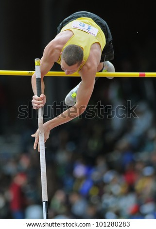 PHILADELPHIA - APRIL 28: A pole vaulter in the boys high school pole vault championship clears the bar at the 2012 Penn Relays April 28, 2012 in Philadelphia.