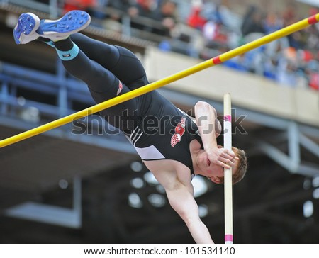 PHILADELPHIA - APRIL 28: Brandon Teribery from Bradford HS competes in the boys high school pole vault championship at the Penn Relays April 28, 2012 in Philadelphia. - stock photo