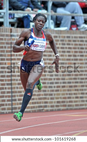 PHILADELPHIA - APRIL 28:Christine Ohurnuogu from Great Britain runs the second leg of the sprint medley at the Penn Relays April 28, 2012 in Philadelphia. - stock photo