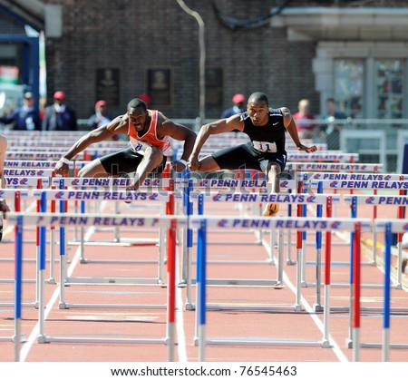 PHILADELPHIA - APRIL 30: Dior Lowery and Naithan Scott (l-r) clear hurdles neck and neck in the Men's Olympic Development 110 meter hurdles at the 117th Penn Relays on April 30, 2011 in Philadelphia, PA