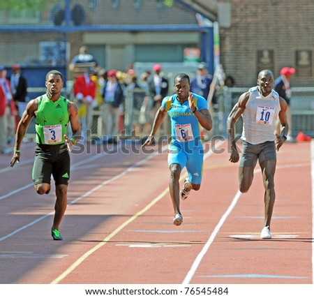 PHILADELPHIA - APRIL 30: Keston Bledman (3) beats Adrian Griffith (6) and Clement Campbell (10) to the finish to win the Olympic Development 100 meter dash at the 117th Penn Relays on April 30, 2011 in Philadelphia, PA. - stock photo