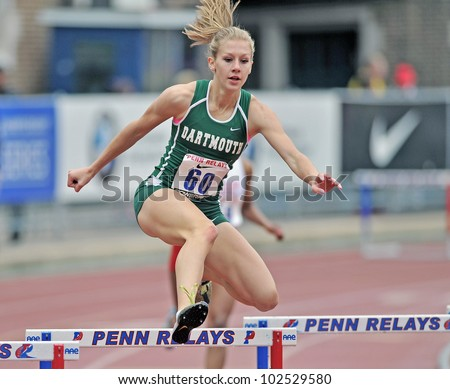 PHILADELPHIA - APRIL 26: Megan Krumpoch from Dartmouth competes in the ladies 400 meter college championships at the Penn Relays April 26, 2012 in Philadelphia. - stock photo