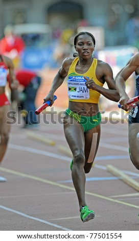 PHILADELPHIA - APRIL 30: Novlene Williams-Mills from Jamaica runs in third place on the back straight during the Olympic Development 4x400 ladies relay at the 117th Penn Relays in Philadelphia. - stock photo