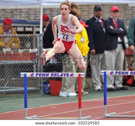 PHILADELPHIA - APRIL 26: Ryan Wooley from Cornell clears a hurdle easily in the ladies 400 meter college championships at the Penn Relays April 26, 2012 in Philadelphia.