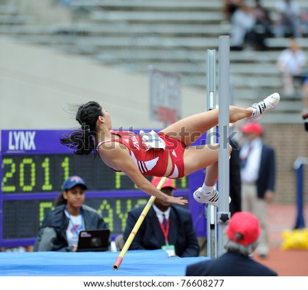 PHILADELPHIA - APRIL 28: The University of Indiana's Emma Kimoto hits the bar failing at this attempt in the high jump at the 117th Penn Relays April 28, 2011 in Philadelphia.