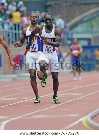 PHILADELPHIA - APRIL 29: Tristan Walker, a member of the LSU men's 4x100 relay team, takes off on the third leg of a heat at the 117th Penn Relays on April 29, 2011 in Philadelphia, PA