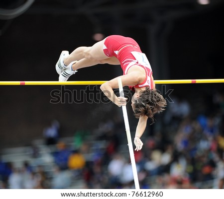 PHILADELPHIA - APRIL 28: Vera Neuenswander from Indiana goes over the crossbar in the ladies college pole vault championship at the 117th Penn Relays April 28, 2011 in Philadelphia.