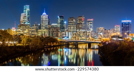 Philadelphia cityscape panorama by night. Schuylkill river reflects the colorful skyscrapers - stock photo