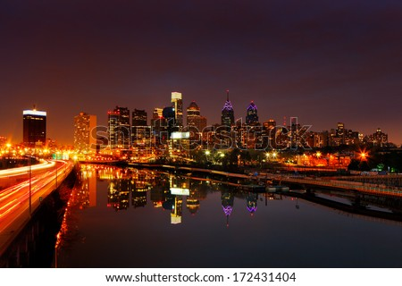 PHILADELPHIA - DEC 2: A dusk image of the City of Philadelphia reflected in the still waters of The Scullykill River, as seen from the South Bridge on Dec 2, 2013 in Philadelphia, USA. - stock photo