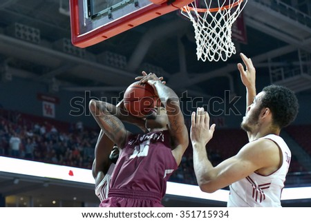 PHILADELPHIA - DECEMBER 13: Saint Joseph's Hawks forward Isaiah Miles (15) has his shot blocked into his face during the Big 5 basketball game December 13, 2015 in Philadelphia.
