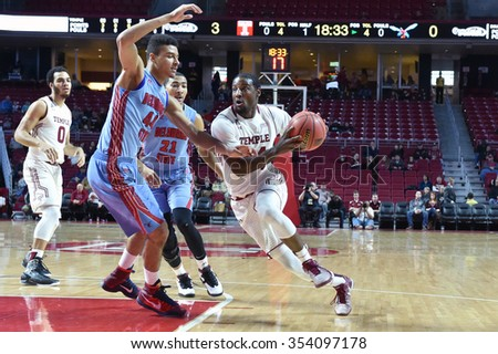 PHILADELPHIA - DECEMBER 19: Temple Owls guard Devin Coleman (34) drives to the basket during the basketball game December 19, 2015 in Philadelphia.  - stock photo