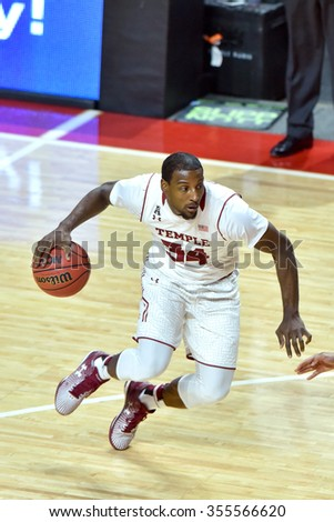 PHILADELPHIA - DECEMBER 19: Temple Owls guard Devin Coleman (34) stops on the tips of his toes as he drives to the basket during the basketball game December 19, 2015 in Philadelphia.  - stock photo