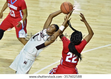PHILADELPHIA - DECEMBER 19: Temple Owls guard Erica Covile (1) fights to control a loose ball during the women's basketball game December 19, 2015 in Philadelphia.  - stock photo