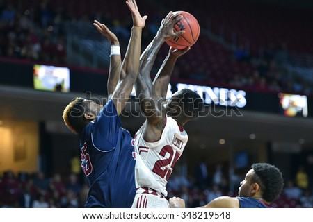 PHILADELPHIA - DECEMBER 2: Temple Owls guard Quenton DeCosey (25) goes up strong with a shot during a NCAA basketball game December 2, 2015 in Philadelphia.  - stock photo