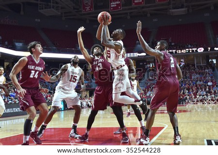 PHILADELPHIA - DECEMBER 13: Temple Owls guard Quenton DeCosey (25) tries to shoot after an offensive rebound during the Big 5 basketball game December 13, 2015 in Philadelphia. - stock photo