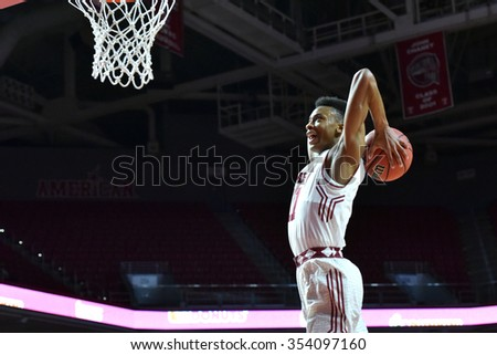 PHILADELPHIA - DECEMBER 19: Temple Owls guard Trey Lowe (11) flies in for a slam dunk during the basketball game December 19, 2015 in Philadelphia.  - stock photo