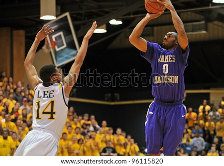 PHILADELPHIA - FEB 22: James Madison Dukes guard A.J. Davis (0) shoots over a Drexel defender during the NCAA basketball game between Drexel and James Madison February 22, 2012 in Philadelphia