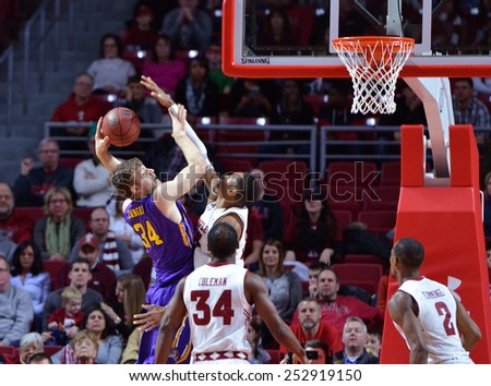 PHILADELPHIA - FEBRUARY 14: East Carolina Pirates forward Michael Zangari (34) loses control of a ball as he shoots during the AAC conference college basketball game January 14, 2015 in Philadelphia.