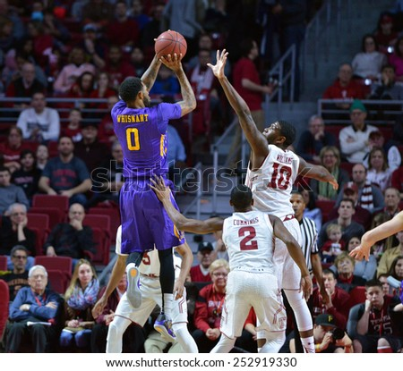 PHILADELPHIA - FEBRUARY 14:ECU guard Terry Whisnant (0) shoots as Temple forward Mark Williams (10) tries for a block during the AAC conference college basketball game January 14, 2015 in Philadelphia - stock photo