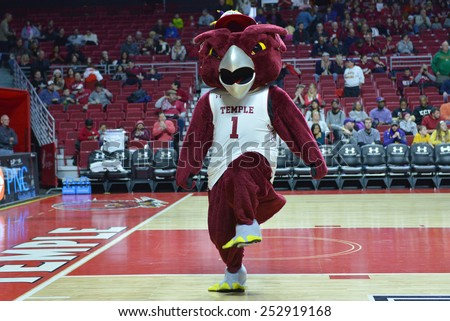 PHILADELPHIA - FEBRUARY 14:  Hooter the Owl, Temple's mascot, celebrates his birthday during the AAC conference college basketball game January 14, 2015 in Philadelphia.  - stock photo
