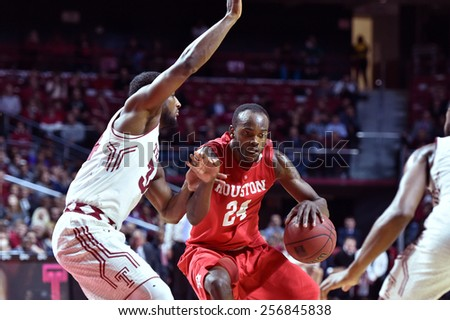 PHILADELPHIA - FEBRUARY 26: Houston Cougars forward Devonta Pollard (24) tries to drives to the basket during the AAC conference college basketball game  February 26, 2015 in Philadelphia.  - stock photo