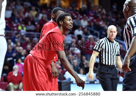 PHILADELPHIA - FEBRUARY 26: Houston Cougars guard Cavon Baker (3) argues about a charging call during the AAC conference college basketball game  February 26, 2015 in Philadelphia.  - stock photo