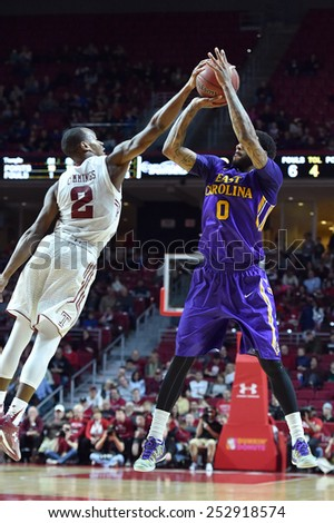PHILADELPHIA - FEBRUARY 14: Temple guard Will Cummings (2) blocks a jump shot taken by ECU guard Terry Whisnant (0) during the AAC conference college basketball game January 14, 2015 in Philadelphia.  - stock photo