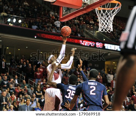 PHILADELPHIA - FEBRUARY 20: Temple Owls center Anthony Lee (3) takes a shot over two UConn defenders in the AAC basketball game played February 20, 2014 in Philadelphia.