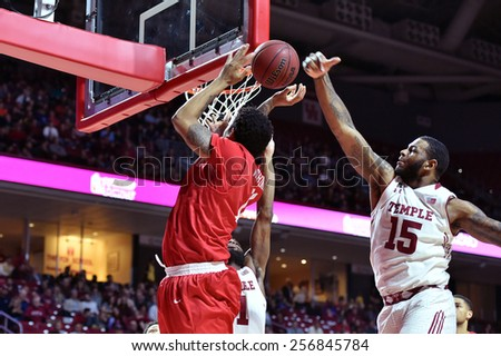 PHILADELPHIA - FEBRUARY 26: Temple Owls forward Jaylen Bond (15) blocks a shot by a Houston player during the AAC conference college basketball game  February 26, 2015 in Philadelphia.  - stock photo