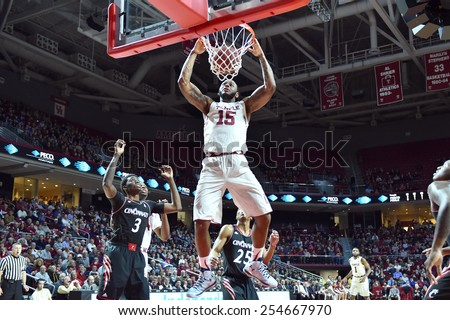 PHILADELPHIA - FEBRUARY 10:  Temple Owls forward Jaylen Bond (15) finishes a slam dunk during the AAC conference college basketball game February 10, 2015 in Philadelphia.  - stock photo