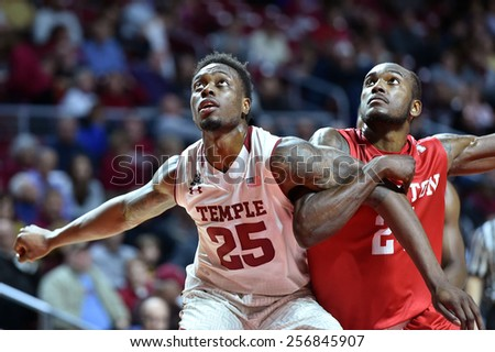 PHILADELPHIA - FEBRUARY 26: Temple Owls guard Quenton DeCosey (25) blocks out a Houston player for a rebound during the AAC conference college basketball game  February 26, 2015 in Philadelphia.