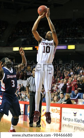 PHILADELPHIA - FEBRUARY 18: Temple Owls guard Ramone Moore (#10) takes a long jumper during the NCAA basketball game between Duquesne and Temple February 18, 2012 in Philadelphia.