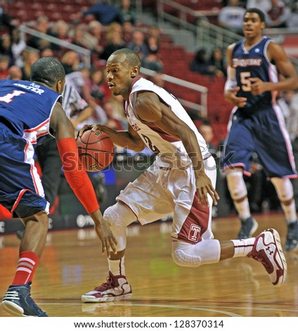 PHILADELPHIA - FEBRUARY 14: Temple Owls guard Will Cummings (2) dribbles with the ball during an Atlantic 10 conference basketball game February 14, 2013 in Philadelphia