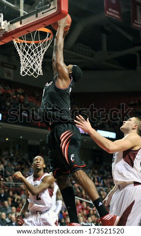 PHILADELPHIA - JANUARY 26: Cincinnati forward Titus Robles (2) elevates for a slam dunk during an AAC basketball game against Temple January 26, 2013 in Philadelphia.