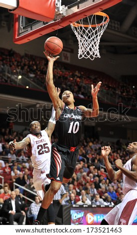 PHILADELPHIA - JANUARY 26: Cincinnati guard Troy Caupain (10) puts up an off-balance shot during an AAC basketball game against Temple January 26, 2013 in Philadelphia.