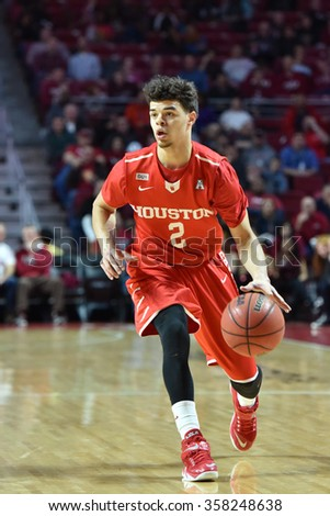 PHILADELPHIA - JANUARY 2: Houston Cougars guard Rob Gray Jr. (2) dribbles the ball during the American Athletic Conference basketball game January 2, 2016 in Philadelphia.  - stock photo