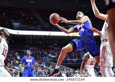 PHILADELPHIA - JANUARY 14: Southern Methodist Mustangs guard Keith Frazier (4) goes up for a shot during the AAC conference college basketball game January 14, 2015 in Philadelphia.  - stock photo