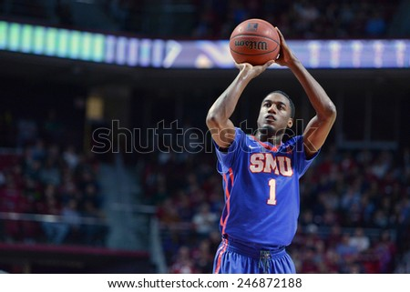 PHILADELPHIA - JANUARY 14: Southern Methodist Mustangs guard Ryan Manuel (1) shoots a free throw during the AAC conference college basketball game January 14, 2015 in Philadelphia.  - stock photo