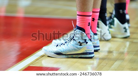 PHILADELPHIA - JANUARY 22: Temple basketball players wear pink shots for breast cancer awareness and special sneakers during the AAC conference college basketball game January 22, 2015 in Philadelphia - stock photo