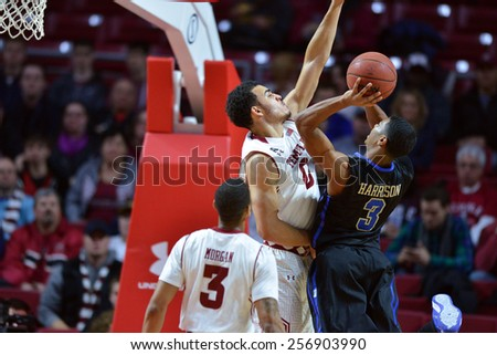 PHILADELPHIA - January 10:  Temple Owls forward Obi Enechionyia (0) goes for a blocked shot during the AAC conference college basketball game January 10, 2015 in Philadelphia.  - stock photo