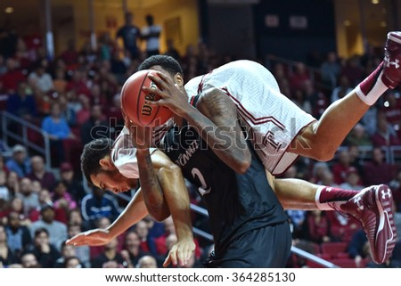 PHILADELPHIA - JANUARY 16: Temple Owls forward Obi Enechionyia (0) goes over the shoulders of a Bearcat  during the American Athletic Conference basketball game January 16, 2016 in Philadelphia.