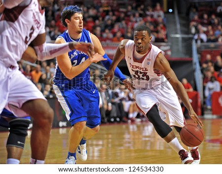 PHILADELPHIA - JANUARY 12: Temple Owls forward Scootie Randall (33) drives with the ball down the lane during the Atlantic 10 basketball game against St. Louis January 12, 2013 in Philadelphia. - stock photo